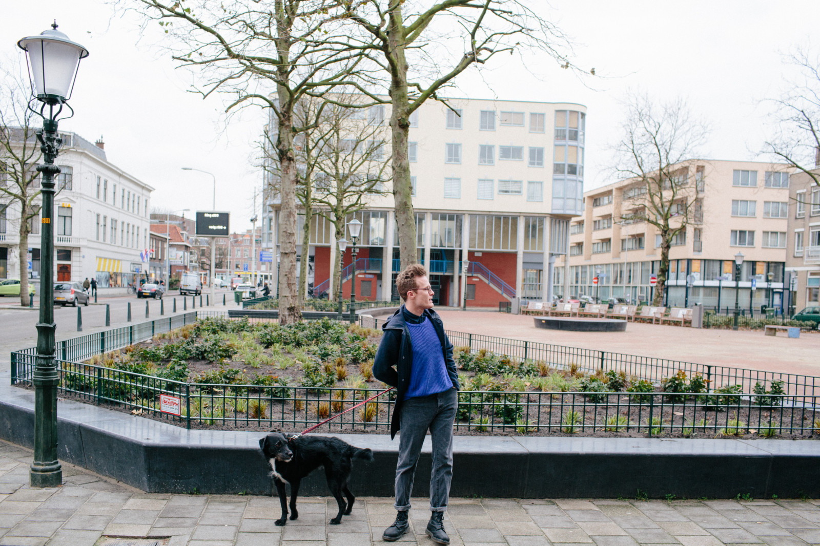 MYKITA FIRST's illustrator Jordy van den Nieuwendijk walking his dog through The Hague.