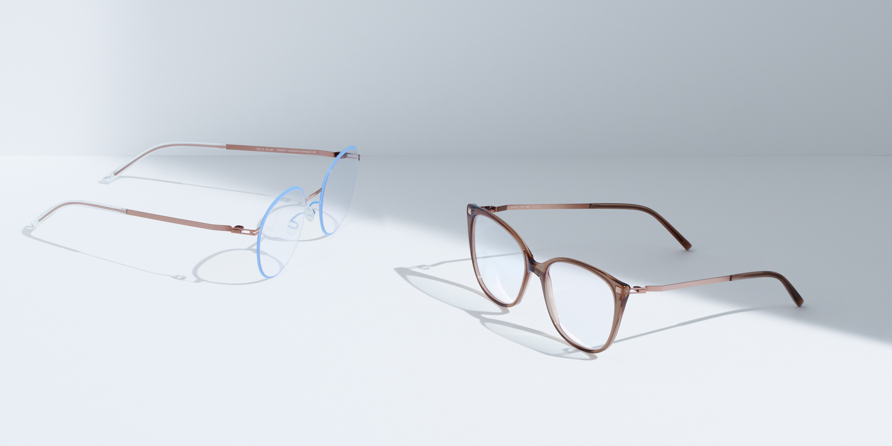 MYKITA Lite Acetate Rx Vabo Shiny Copper Light Blue Clear MYKITA Lite Acetate Rx Osha C73 Topaz Shiny Copper Clear